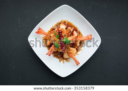 Deep Fried Shrimp with Tamarind Sauce, Top view on black background - stock photo