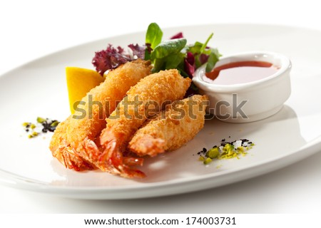 Deep Fried Shrimps with Fresh Salad Leaves and Spicy Sauce - stock photo
