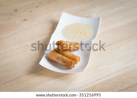 Deep fried spring rolls with pork stuffed serve with sweet sauce that found in East Asian and Southeast Asian cuisine.(soft focus) - stock photo