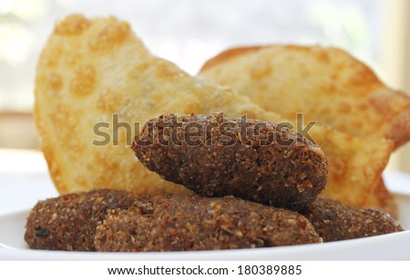 Deep fried stuffed pastry. - Pastel food in Brazil - stock photo