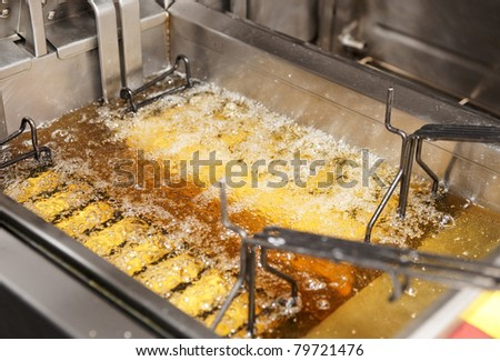 Deep fryer with boiling oil - stock photo