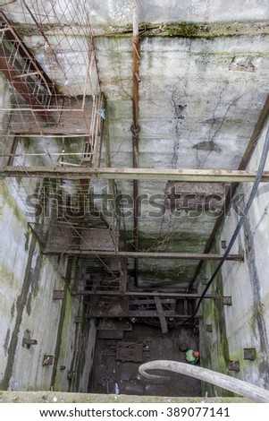 Deep Mine with reinforced concrete artificial landings for the process of descent into the underground tunnel. Engineering structures. Strategic military facility. Sewerage treatment plants - stock photo