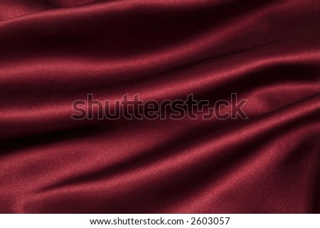deep rich cherry coloured satin. folded and flowing background - stock photo