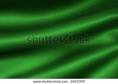 Deep, rich, emerald coloured satin. Folded and flowing background - stock photo
