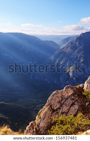 Deep river canyon before sunset - stock photo