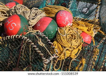 Deep sea fishing equipment on a boat in the harbor, fishing nets, buoys, lobster pots and robes.  Fishing industry of the Western Cape, South Africa.