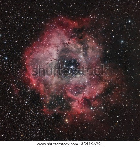 Deep Sky Astronomy Object in the Night Sky - Rosette Nebula through a telescope - stock photo