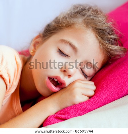 Deep sleeping children girl closeup portrait on pink pillow - stock photo