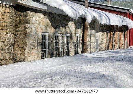 Deep Snow On Roof and Against Old Abandoned Factory - stock photo