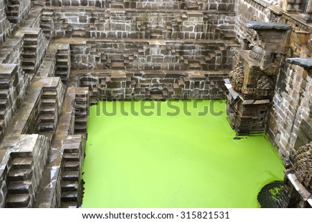 Deep stepwell Chand Baori in the village of Abhaneri near Bandikui, Rajasthan, India - stock photo