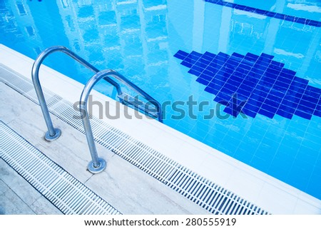 Deep swimming pool with pure clean water - stock photo