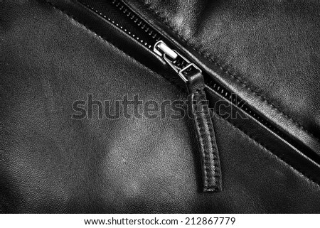 Deep textured leather jacket with silver zipper - stock photo