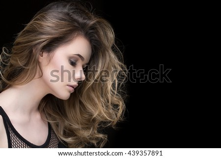 Deep thinking. Studio portrait of a beautiful fair haired female posing thoughtfully on black background copyspace on the side - stock photo