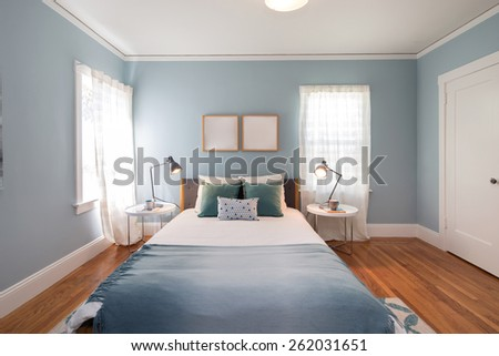 Deep Turquoise Blue bedroom with matching decoration.  - stock photo