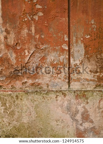 Deep Tuscan orange with sections of light green moss accent this background image. - stock photo