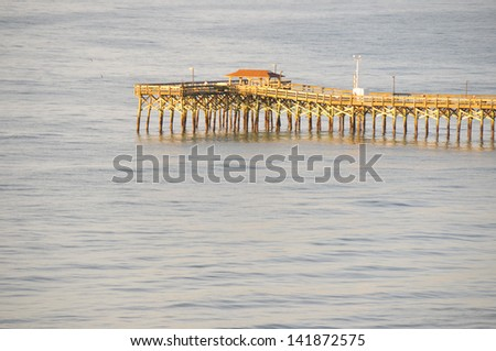Deep water fishing Pier off the South Carolina Coast from the air in early morning light - stock photo