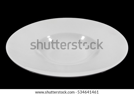 Deep white small soup plate with wide shoulders on black background from side