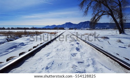 Deep Winter Train Tracks and Mountains