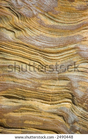 Deeply weathered sandstone wall of a seaside cliff - stock photo