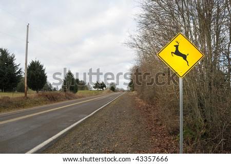 Deer Elk Crossing Road Sign in a contry rura street road - stock photo
