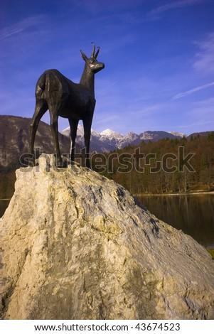 Deer statue in Bohinj lake, Slovenia - stock photo