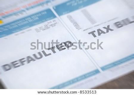Defaulted tax bill with zoom blur - stock photo