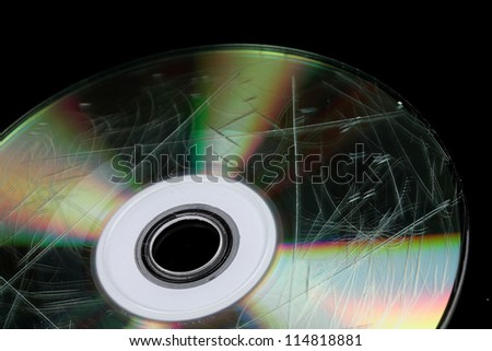 Defective disk with information isolated on black - stock photo