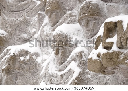 """Defenders of Stalingrad, a fragment of a bas-relief of """"Wall ruins"""" on Mamayev Kurgan in the winter - stock photo"""