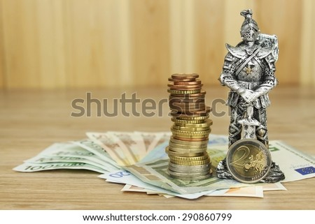 Defending European Union, protection of the common currency. Danger for EURO currency. Knight prevent euro coins. Fight to maintain the common currency of the European Union. - stock photo