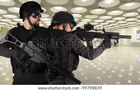 Defense against terrorism, two soldiers at an airport