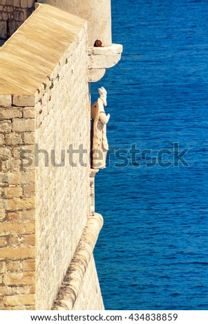 Defensive walls of Dubrovnik Fortress in Croatia. One of the greatest fortifications of Middle Ages and popular touristic destination nowadays, included in UNESCO list of World Heritage Sites - stock photo