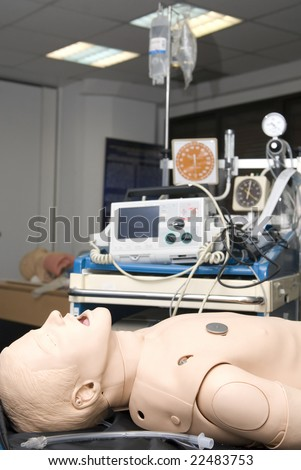 Defibrillator on a dummy for practisse - stock photo
