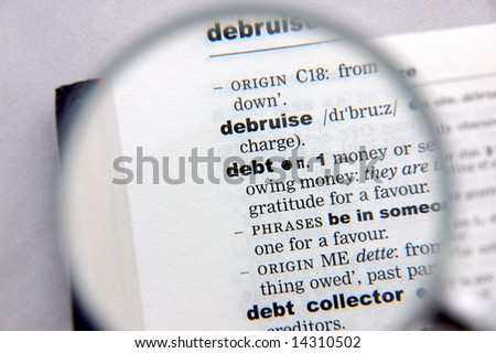 Definition of debt emphasized by a magnifying glass