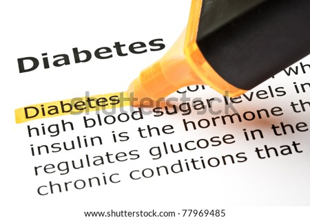 Definition of Diabetes highlighted with orange marker. - stock photo