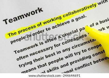 definition of teamwork - stock photo