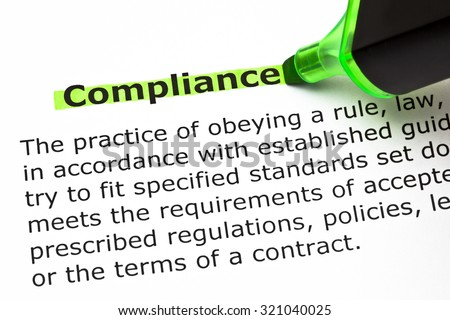 Definition of the word Compliance, highlighted with green felt tip pen. - stock photo