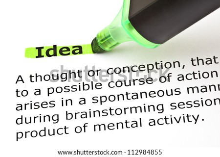 Definition of the word Idea highlighted in green with felt tip pen - stock photo