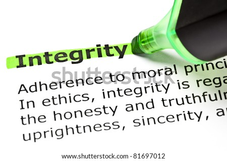 Definition of the word Integrity highlighted in green with felt tip pen. - stock photo