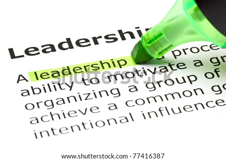Definition of the word Leadership highlighted in green with felt tip pen. - stock photo