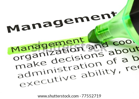 Definition of the word Management highlighted in green with felt tip pen. - stock photo
