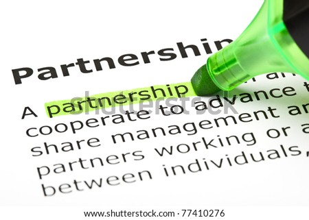 Definition of the word Partnership highlighted in green with felt tip pen. - stock photo