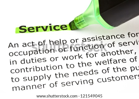 Definition of the word Service, highlighted in green with felt tip pen - stock photo