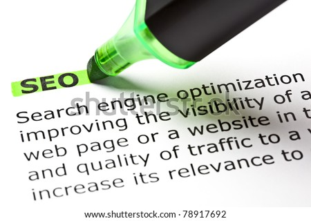Definition ot the acronym SEO highlighted with green marker. - stock photo