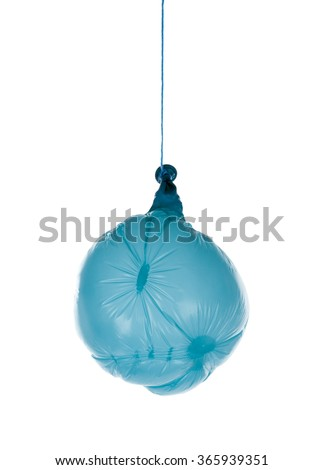 Deflated blue balloon at a rope; isolated over white