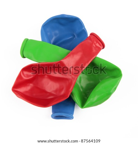Deflated red, green and blue Balloons - stock photo