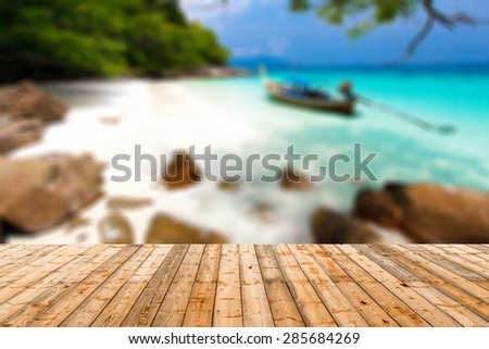 Defocus and blur image of old wood and Beautiful tropical beach in Thailand - stock photo