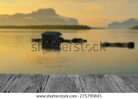 Defocus and blur image of old wood and Sunset at dawn in Phang Nga ,Thailand for background usage - stock photo