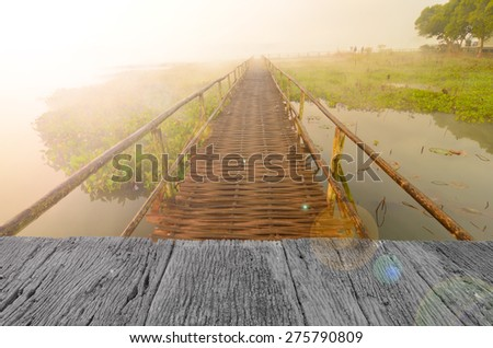 Defocus and blur image of old wood and wood bridge in the forest for background usage - stock photo