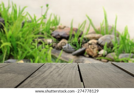 Defocus and blur image of terrace wood and beautiful garden for background usage - stock photo