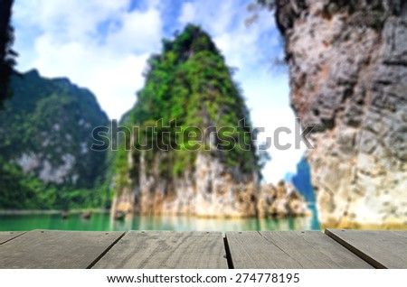 Defocus and blur image of terrace wood and beautiful Jetty walkway Guilin Thailand at suratthanee for background usage - stock photo